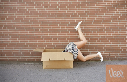 Woman Falling in Cardboard Box