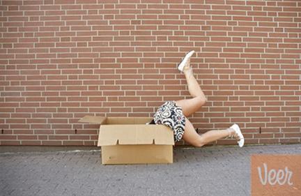 Woman Falling in Cardboard Box